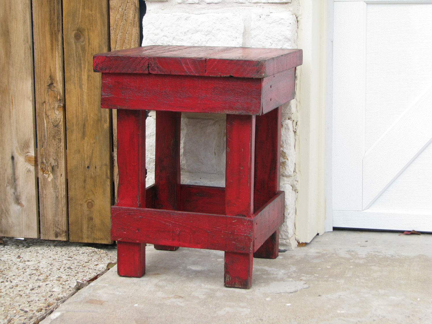 small rustic red end table -